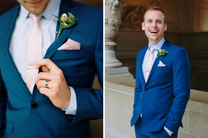 Groom showing off his blue suit after his San Francisco City Hall wedding