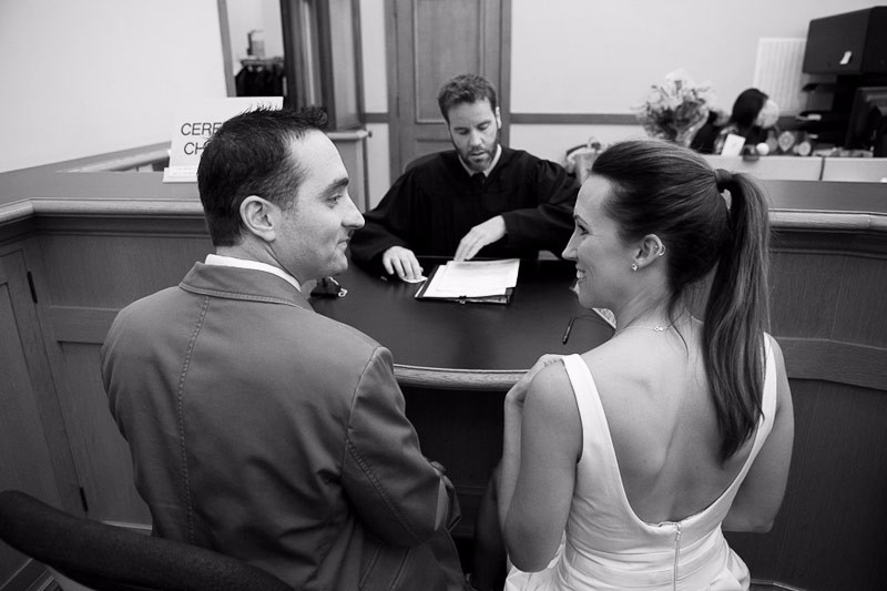 San Francisco City Hall wedding. Bride and groom in the County Clerks Office before their ceremony.