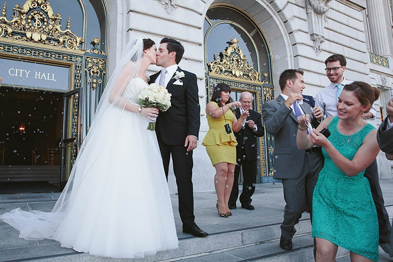 San Francisco City Hall wedding. Guests blowing bubbles.