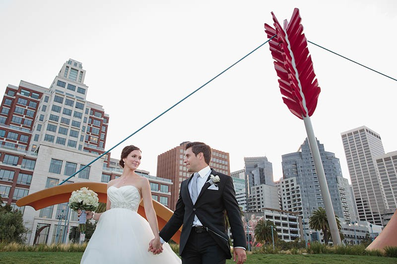 San Francisco City Hall wedding. Bride and groom walking along the Embarcadero.