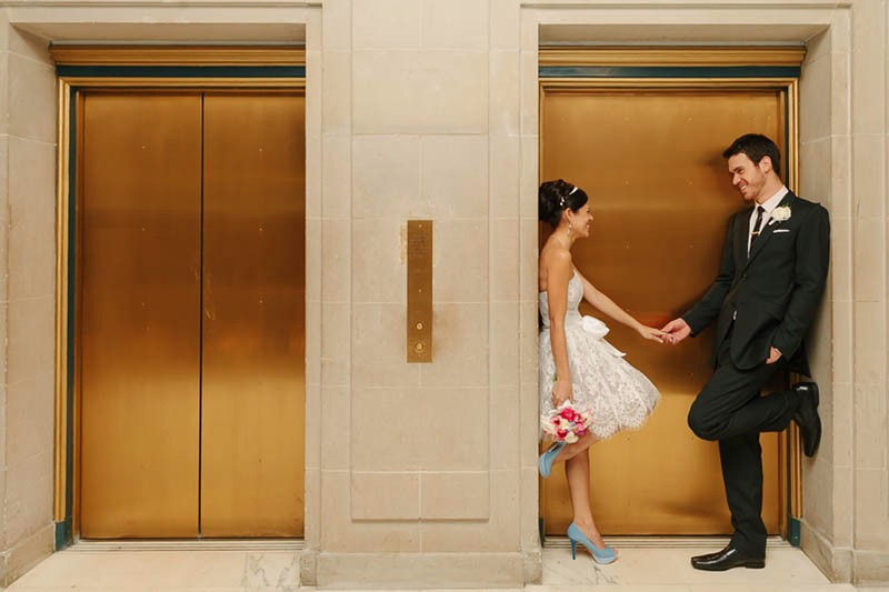 San Francisco City Hall wedding. Bride and groom near elevators.
