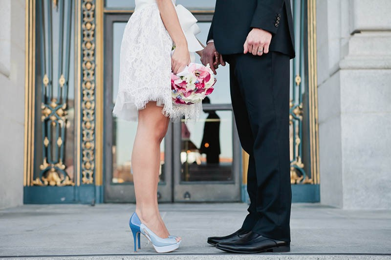 San Francisco City Hall wedding. Closeup of bride and groom's shoes.