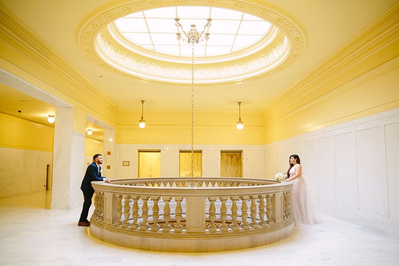 Bride and groom on the Fourth Floor of San Francisco City Hall