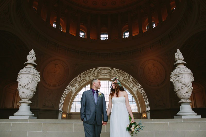 San Francisco City Hall wedding. Bride and groom standing on Fourth Floor.