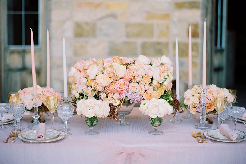 Pink, blush, and pastel floral arrangements at a Sunstone Winery wedding