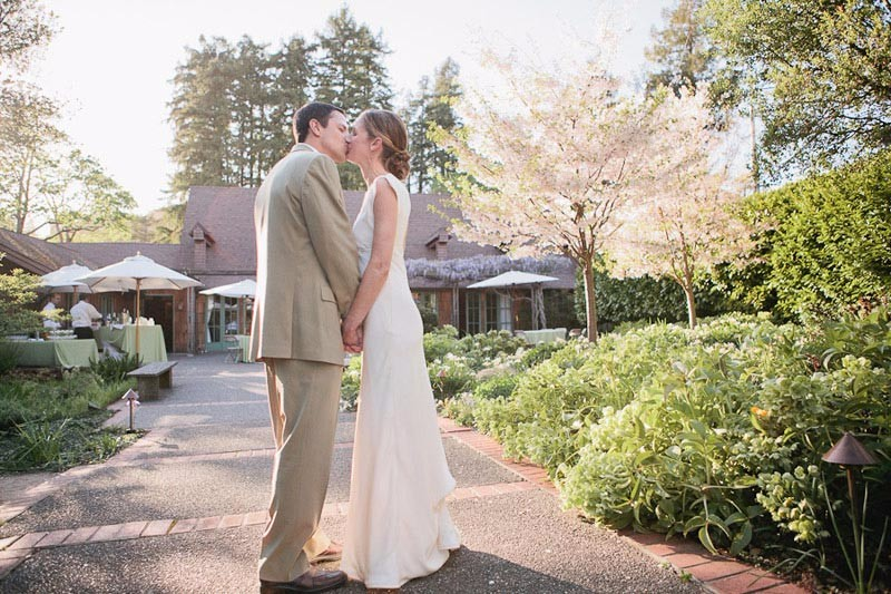 Bride and groom kiss after their Outdoor Art Club wedding in Mill Valley