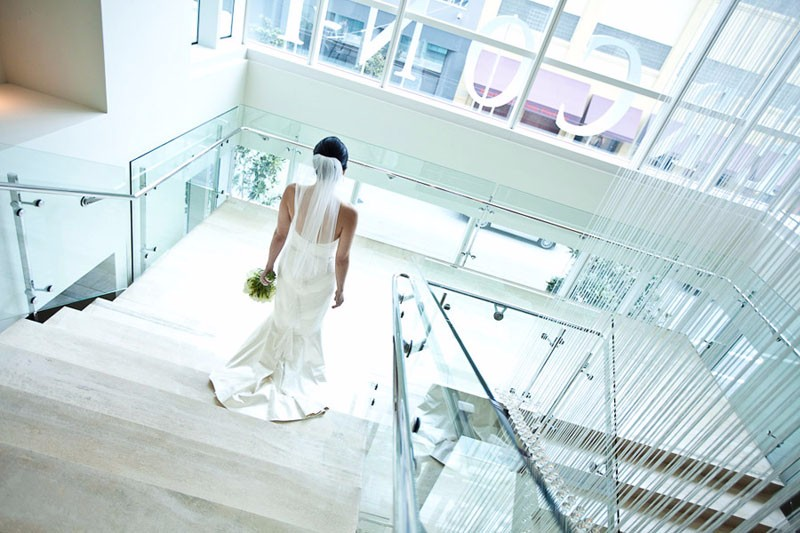 Bride walking down the stairs at the Hotel Intercontinental in San Francisco