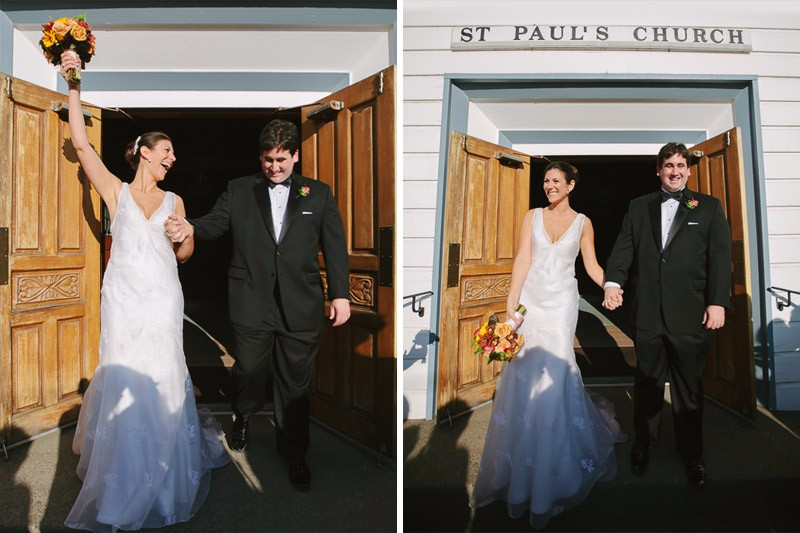 Bride and groom triumphantly walk out of St. Paul's Church in Healdsburg after their wedding ceremony