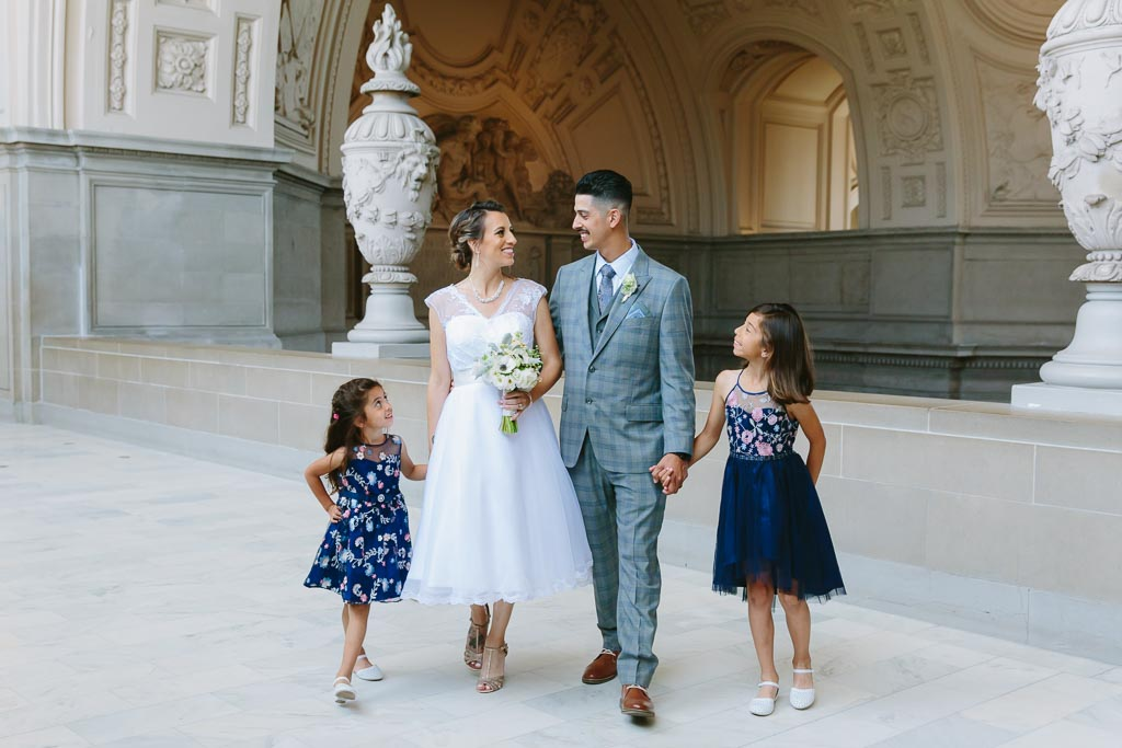 San Francisco City Hall Wedding Photographer. Bride and groom getting married with their children joining them for their wedding ceremony. Family portrait at City Hall.